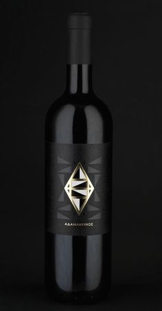 Adamantino wine label and bottle - spot UV varnish and gold foil
