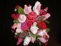 Bouquet made from baby socks, bibs & onsies - great gift.