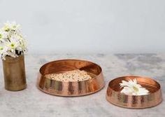 Handcrafted by Tambat artisans. Sprituality and the resonance floater, a product of copper urli range.