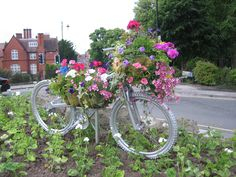 Paint an old bike and add flowers!