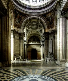 ancient greek interior, the style is seen in the grand arches and the pattern of the mosaic flooring