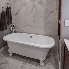 The art deco style Richmond bath adds luxury to this bathroom, whilst the chandelier gives a feel of traditional elegance.