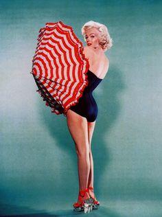 Marilyn Monroe photographed by Bert Reisfeld, 1953.(umbrella session).
