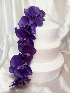 Purple Wedding Cake Design Artificial Orchids Flowers Topper (purple) Fabulous Fascinators http://www.amazon.co.uk/dp/B008IHKG8S/ref=cm_sw_r_pi_dp_BXGqvb12BF301