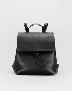 The timeless classic. A simple, understated, hardworking minimal leather backpack in soft tumbled leather.