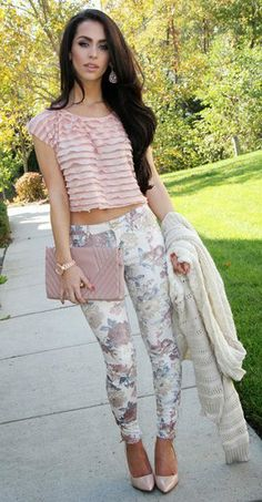 Blush ruffled top, cream cardigan, light wash floral jeans, blush clutch and pumps