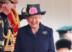 Her Majesty laughs as she arrives to welcome the President of Singapore Tony Tan Keng Yam