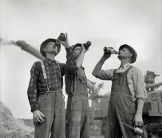 To Agriculsha! Fall 1941. Jackson, Michigan. Threshing wheat. Farmers drinking beer. Photo by Arthur Siegel for the Farm Security Administration.