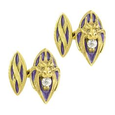 A pair of Art Nouveau yellow gold and enamel cufflinks