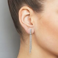 These dramatic Shine earrings made with eight diamond-cut rhodanized silver strands of different lengths give these earrings the perfect sweep and sparkle. They are a stunning addition to any outfit, adding a touch of contemporary glamour.
