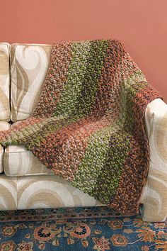 Lion Brand Spiced Knit Afghan (free pattern with account) -- love these colors.    Pictured (I believe): Pumpkin, Oatmeal, Grass, Eggplant.
