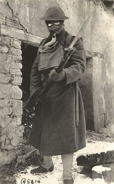 US Marine - CPI Photo Photo of a US Marine in the Lorraine, France region with gas mask and bayonet at the ready. WW 1.