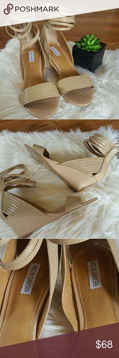 Kelsi Dagger Tallia Wedge Leather Sandal Beautiful Wedge sandal mid heel wedge. Leather upper .  Strappy ankle cuff with zip closure at back. Padded synthetic insole.  2 1/2 inch heel  This stunning sandals were  wore one time for a Wedding . They have been in my closet since then. The sandals are perfect for Spring and Summer time!!!  Great condition!!!! Kelsi Dagger Shoes Sandals