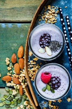 #Healthy berry smoothie  Mason jars of fruits smoothie with pumpkin and chia seeds on old rusty iron background over rustic wood table top view selective focus. Detox Diet Well being and weight loss concept