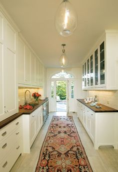 A butler's pantry adjoins the kitchen and supplies storage and a door to the back terrace at the Evermay estate in Georgetown.