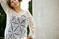 Merezhka is a crocheted top which takes its name from a Ukrainian traditional embroidery stitch (hem-stitch). This stitch is worked by pulling out strands of thread which are used to create lacy lines in the fabric (merezhki).