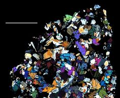 Asteroid Minerals  Image courtesy U. Tenn, SI, and Caltech/NASA    Seen under a microscope, minerals in a meteorite look like laundry scattered across black velvet in a newly released picture.    The sample is from a so-called HED—howardite, eucrite, and diogenite—meteorite found in Antarctica. HED meteorites are believed to originate from the asteroid Vesta. The texture of this rock is what would be expected from the crystallization of molten magma.    NASA hopes to compare such samples to data from the Dawn spacecraft, which is currently orbiting Vesta in the main asteroid belt, between the orbits of Mars and Jupiter.    Published December 9, 2011