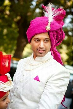 Groom in a pink paagdhi! Got to love it