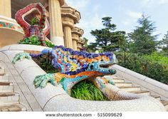 stock-photo-park-guell-in-barcelona-frog-sculture-fountain-at-main-entrance-covered-with-pieces-of-colorful-515099629.jpg
