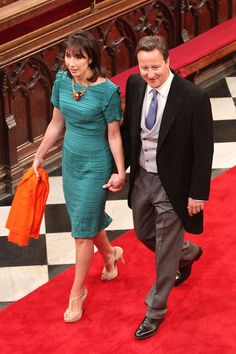 Samantha Cameron - in a Burberry dress, Aldo shoes and Erdem jewels - with the Prime Minister, David Cameron.