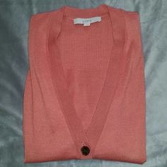 LOFT Salmon boyfriend cardigan sz Small Great addition to any wardrobe! Great layered or in the warmer months over a tank. Large buttons and longer length.   This cardigan is in EUC. There is a super tiny hole in the back of the cardigan (pictured) not noticeable at all when worn.   Size small Length 28  Please let me know if you have any questions or would like additional pictures. Thank you! LOFT Sweaters Cardigans