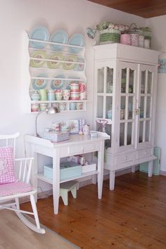 Pretty plate rack with pastel china against white