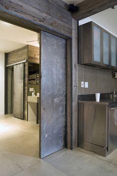 POCKET DOOR PERFECTION: modern #industrial kitchen design with a sliding metal pocket #door