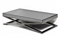 "Our new custom Black Chrome X-Leg coffee table, complete with all around smoked mirror top, will wow anyone and inject some sophistication and edgy style to your pad. 51"" Wide / 27.5"" Deep / 13"" Tall"