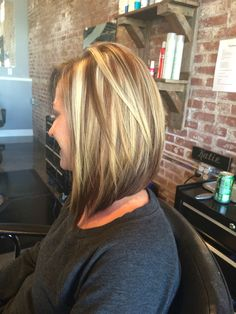 Beautiful color and a long swing bob haircut. Dark underneath. Chunky hi lights and lowlights.