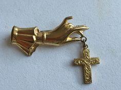 Vintage Gold Hand Brooch with Cross by victoriansentiments on Etsy https://www.etsy.com/listing/251860965/vintage-gold-hand-brooch-with-cross