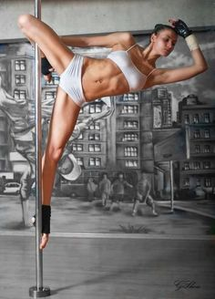pole dance - tried this once...  those are some STRONG ladies! wowza