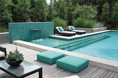 Beautiful integration of hardscaping (the mosaic tile water feature) with furnishings (the gorgeous aqua cushions) in this modern landscape. Design by Bonick Landscaping of TX.