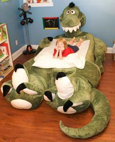 This is a first - I've never seen a stuffed animal and bed merged into one thing. I wish they had a turtle for E.