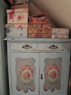 Sweet Blue Chippy Cupboard...with floral fabric inserts.