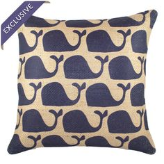 Handmade jute pillow with a whale pattern.