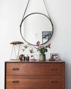 I like the how this mirror is hanging. And the shape.