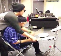 Michael just wants to play the drums!! But i think he is cheating on his other teacher, calum, with ashton haha.