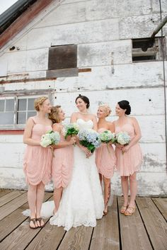 Simple pale pink short bridesmaid dresses | Rustic Chic Nautical Infused Port Edward British Columbia Coastal Wedding | Photograph by Stefania Bowler Photography  http://www.storyboardwedding.com/romantic-nautical-port-edward-british-columbia-wedding-north-pacific-cannery/
