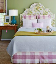 This inviting room offers traditional country charm with a few fresh updates. For a fresh, not fussy, approach, stick to one color scheme and balance large-scale prints (like the floral and gingham) with small ones (like the plaid and block print).