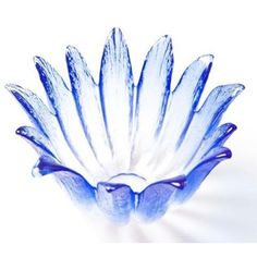 Mats Jonasson Målerås  Corona Votive - Blue: Just add a tealight and watch this little hand-made flower bowl come to life as the crystal picks up reflected light and gives the glass extraordinary luster and brilliance.