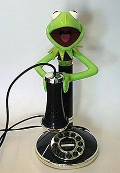 In 1996 TeleDynamics released a Kermit the Frog candlestick telephone as a part of the Kermit Collection. The old-fashioned phone includes a pick-up receiver; Vintage Phones, Vintage Telephone, Vintage Toys, Sapo Kermit, Et Phone Home, Antique Phone, Retro Phone, Call Me Maybe, Kermit The Frog