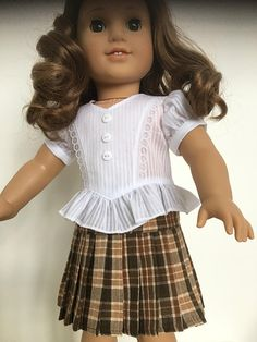 Frilly ruffles blouse with a brown plaid skirt. Both items are my own pattern design. The skirt has an elastic waist for ease of dressing and helps with fit to various dolls. It is made of a quality cotton and has delicate pleats all around. A small roll hem is just above knee