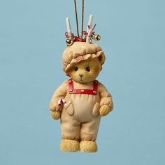 Bear Dressed as Reindeer Ornament Dated 2015 The new 2015 dated holiday ornament bear is dressed up in a cute reindeer outfit. He has jingle bells on his matching hat with antlers. A great new addition to your Holiday Ornament collection. Hanging Ornament 3.875 in H