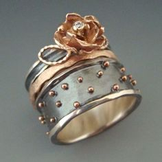 Ring   Anne Marie Cianciolo. Oxidized sterling silver, 14k rose gold, diamond...beautiful!