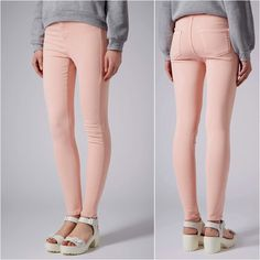 TOPSHOP | Peach Pink Joni High Rise Skinny Jeans Brand: Topshop Style: Joni Jeans Color: Light Peach Pink Size: 30x32 (best fits US 28, 29/sizes 6, 8)  These jeans are in very good condition. The material is extremely stretchy. They have two back pockets; no belt loops. There are a couple of marks on the hem of the pants which can be seen in the third photo of the first collage. If you wish, you can simply cuff them as shown in the last photo of the first collage.  Sold out on Topshop.com…