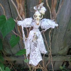 Voodoo Twig Doll made with real muskrat skull, antique lace, graveyard sticks and graveyard dirt.  Made by Mary Anne McClusky of Mayham Market  https://www.etsy.com/shop/MayhamMarket  halloween #spooky #bones #spoopy #jewlery #creepy #graveyard #handmade #diy #skull #mayhammarket #voodoo #vodun #etching #glassware #earrings #necklace #teeth #doll #steampunk #oddities #curiosities #antiques #recycle #primitive #upcycle #goth #punk #gardening #witch #witchcraft #weird #monster