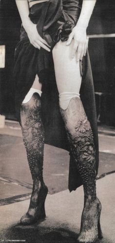 """""""And you know, the fact is, nobody knew that they were prosthetic legs. They were the star of the show - these wooden boots peeking out from under this raffia dress - but in fact, they were actually legs made for me.""""  Aimee Mullins, on her look in the Alexander McQueen S/S 1999 show."""
