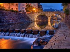-Meganebashi Bridge, nagasaki japan-  This bridge is very photogenic. Go to the water level to get the best pictures. Twilight is a great time...