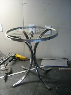 Post with 27 votes and 826 views. An end table I made out of a bike rim and wheel for a friends wedding gift! Garage Furniture, Automotive Furniture, Unique Furniture, Diy Furniture, Bicycle Wheel Decor, Bicycle Rims, Steampunk Furniture, Wedding Gifts For Friends, Wicker Table