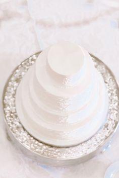 A simple white elegant wedding cake #brideside #realwedding #wedding #simple #white #cake #elegant #weddingcake A beautiful powder pink wedding full of soft romance | Brideside